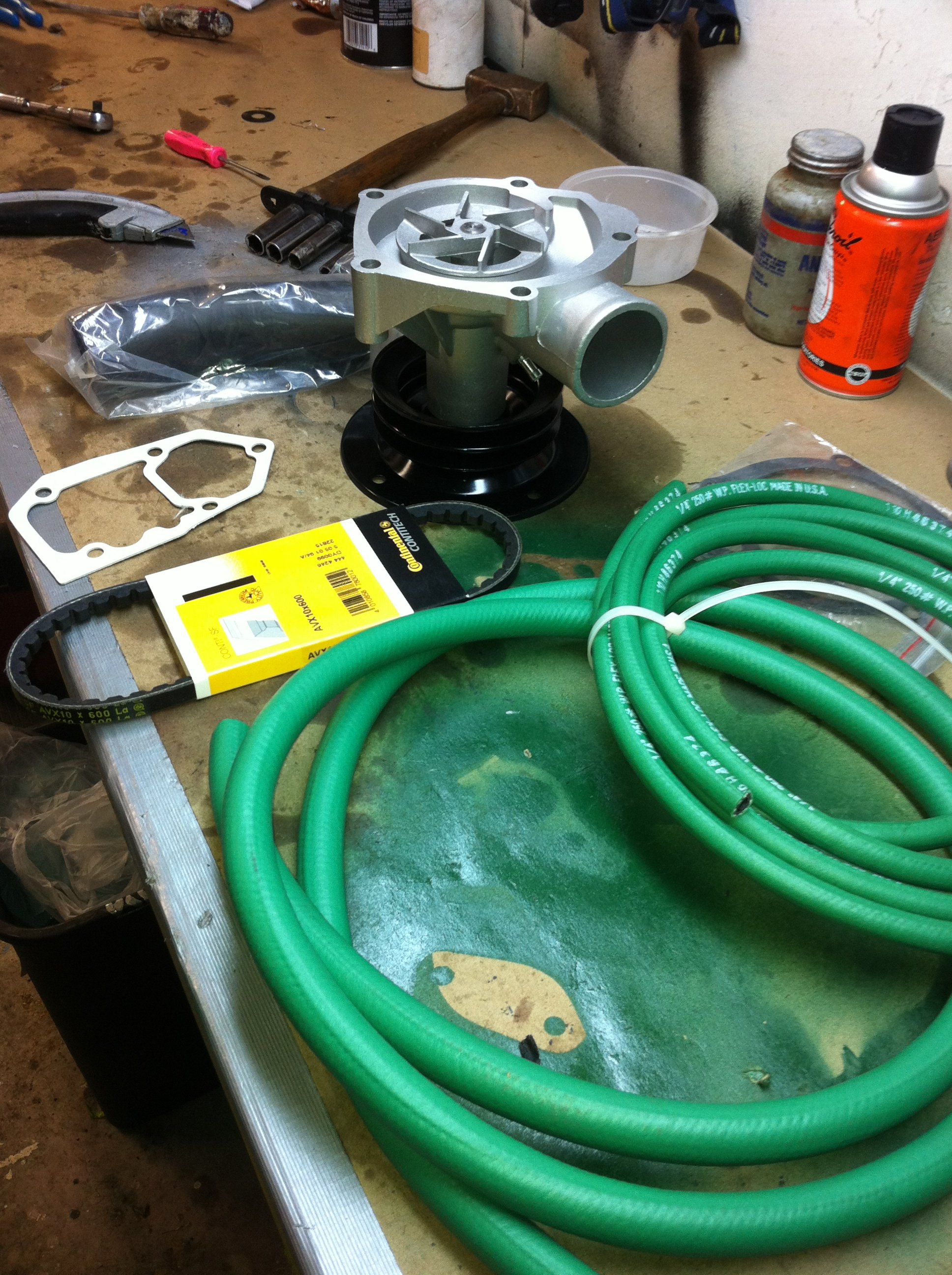 New water pump and green hydraulic hose arrive