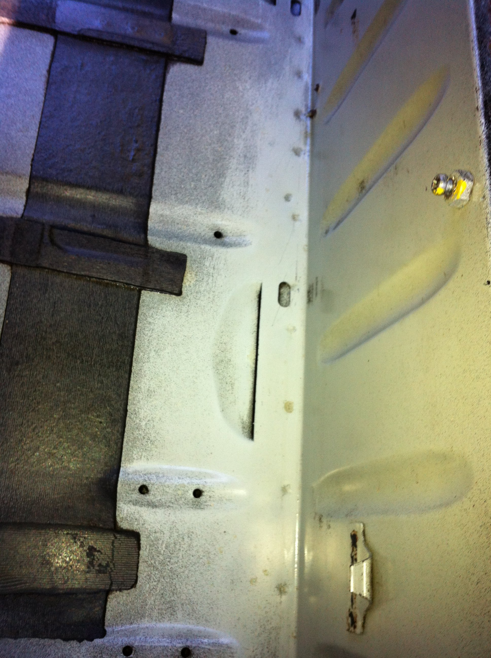 The fuel tank bay is clean and rust-free. This car is in excellent structural condition.