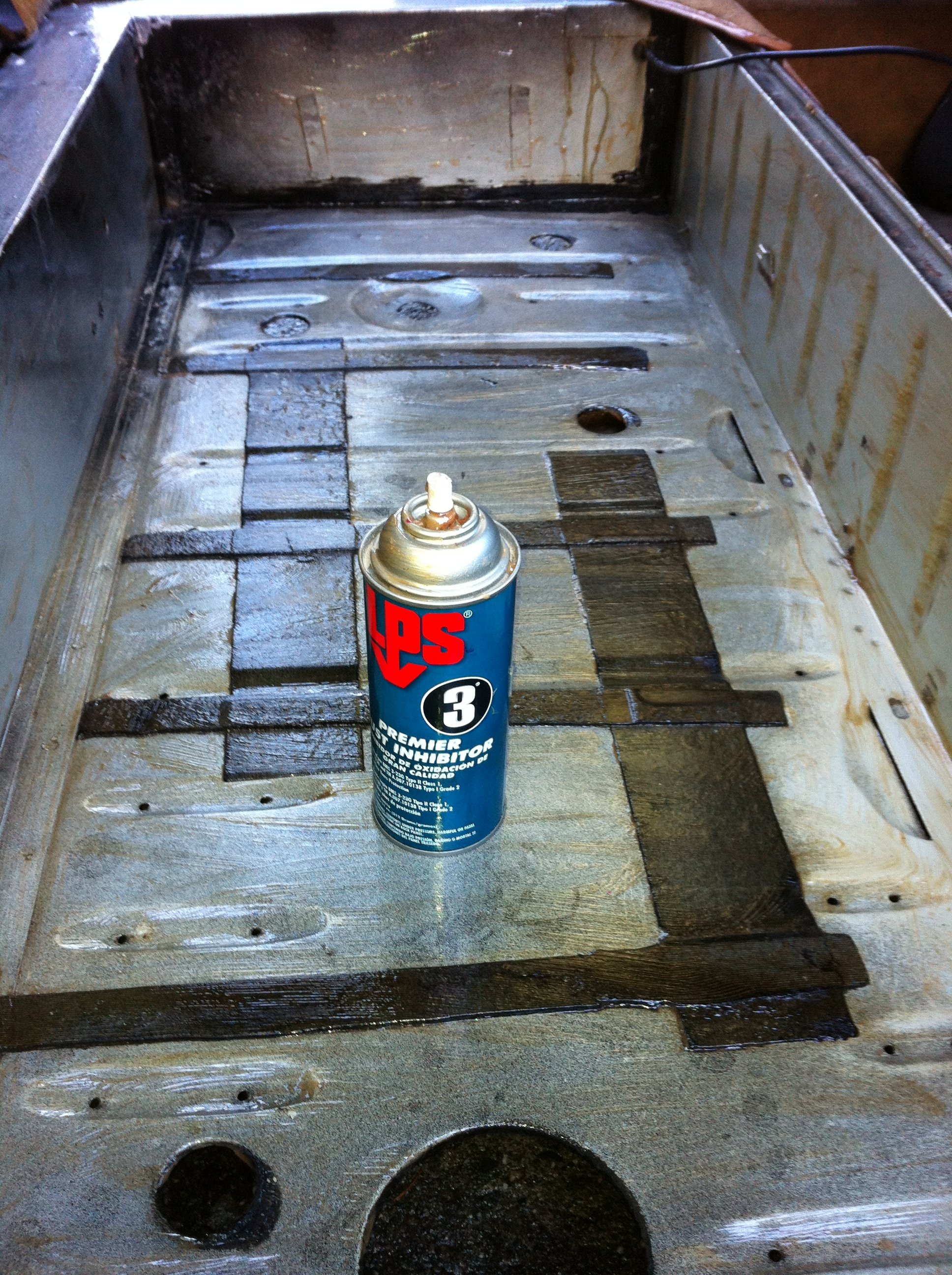 Prior to installing fuel tank, I apply LPS-3 to the fuel tank bay.