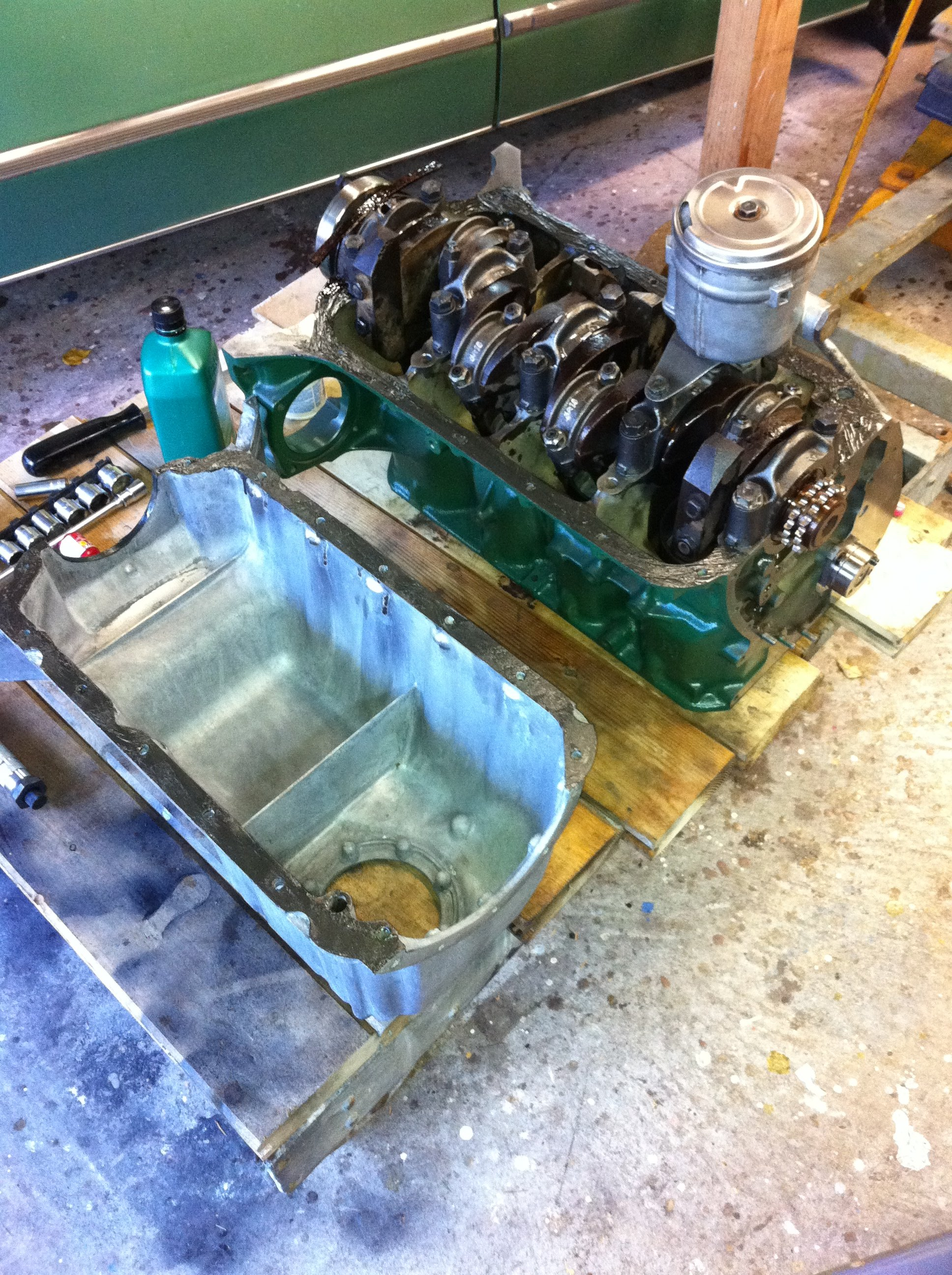 After the oil pump and filter housing goes in, the sump goes on