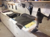 Many yards of fiberglass, kevlar and carbon fiber cut in preparation for layup