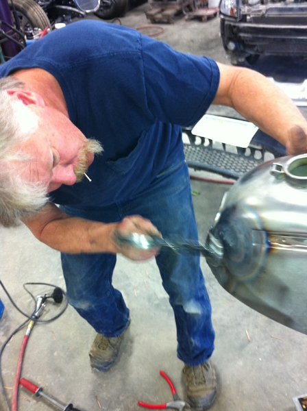 After pulling the dent out with the studs, Pat does some hammering to get it close to the correct shape