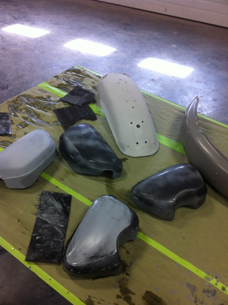 Two sets of SL 350 parts primed and coated with a sanding reveal coat to show the high spots and dimples