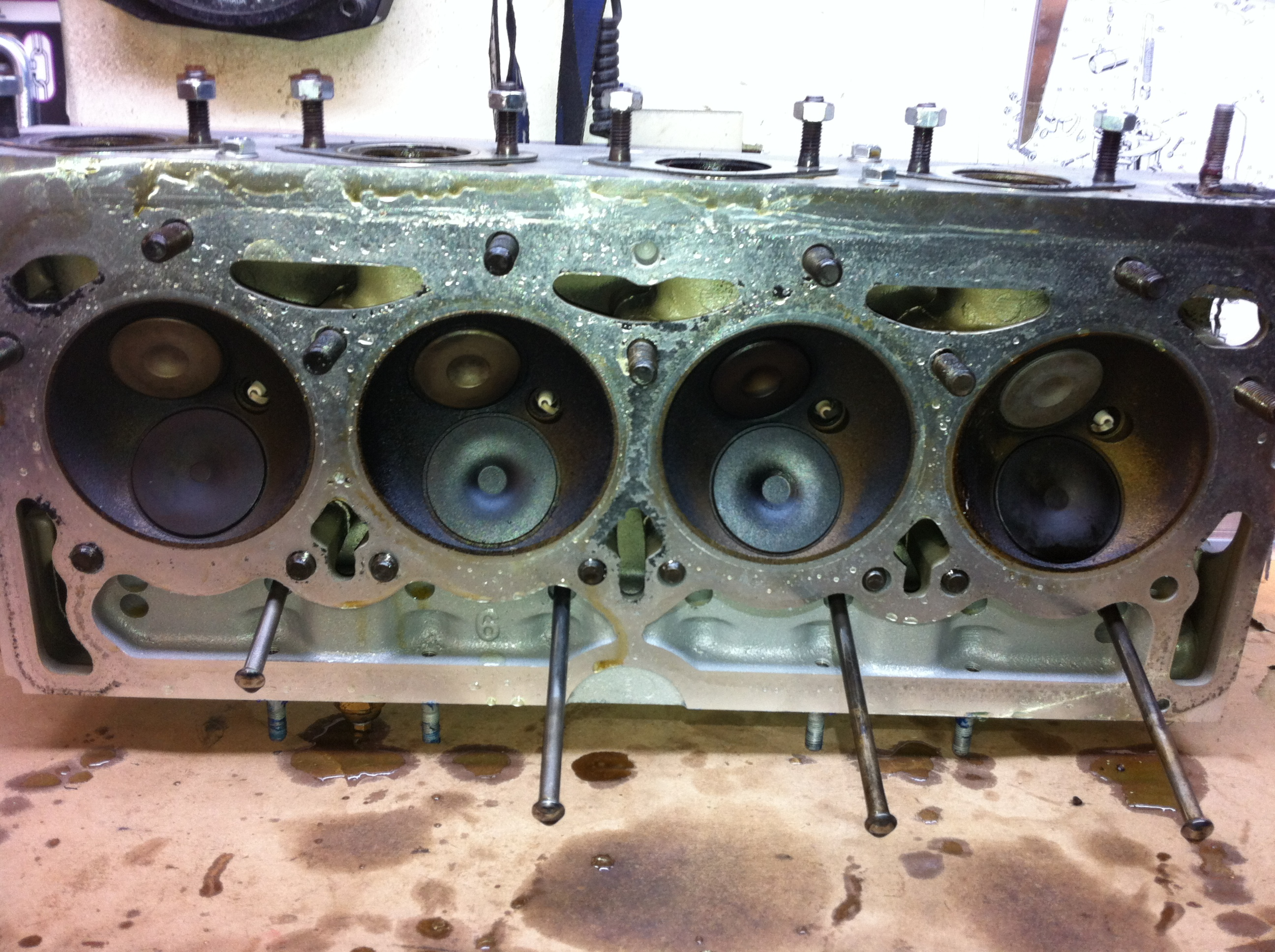 Head has oil residue built up thickly on the combustion chambers
