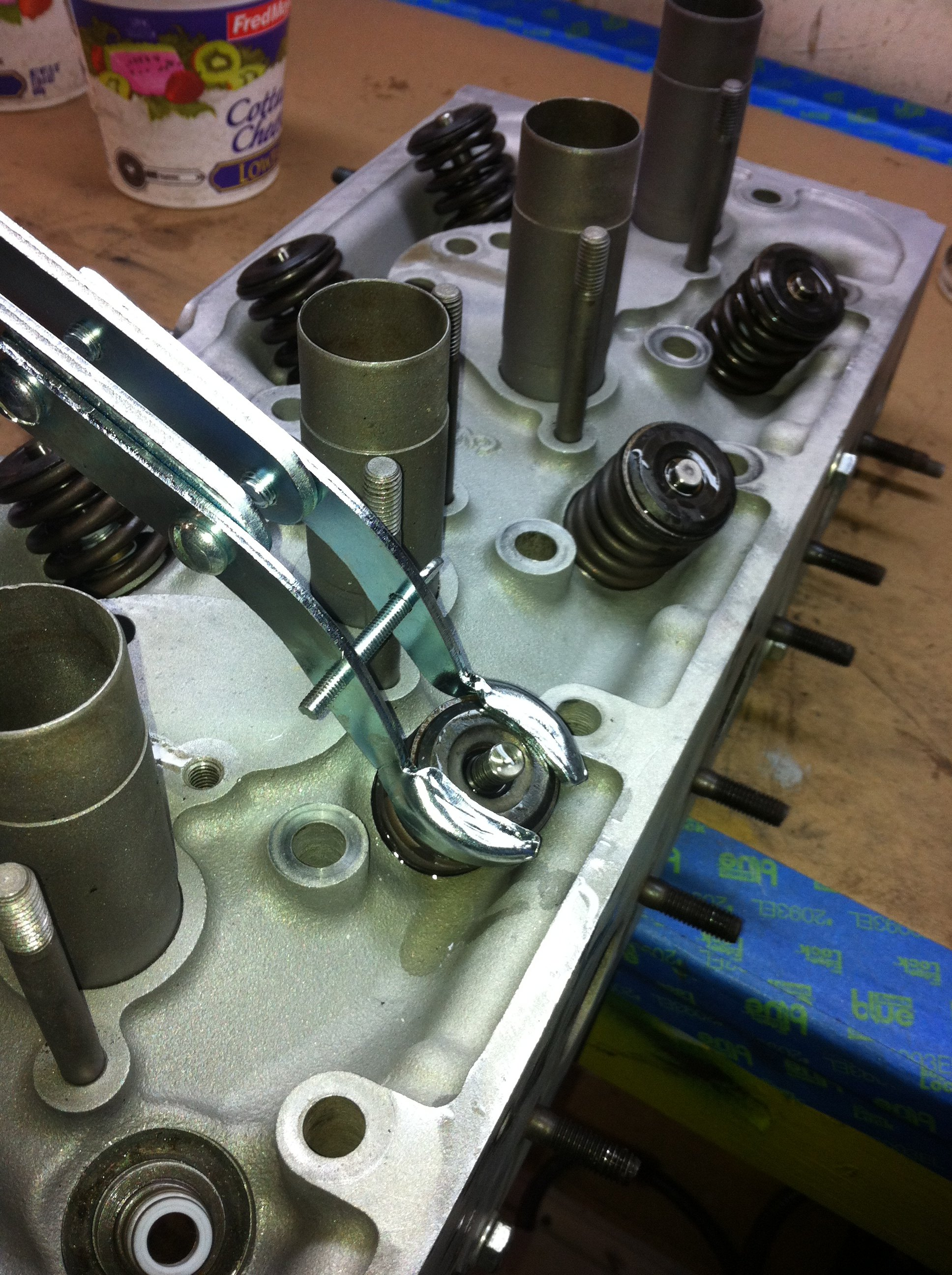 Back to work on the head - re-installing the valve springs after the seals are glued in place