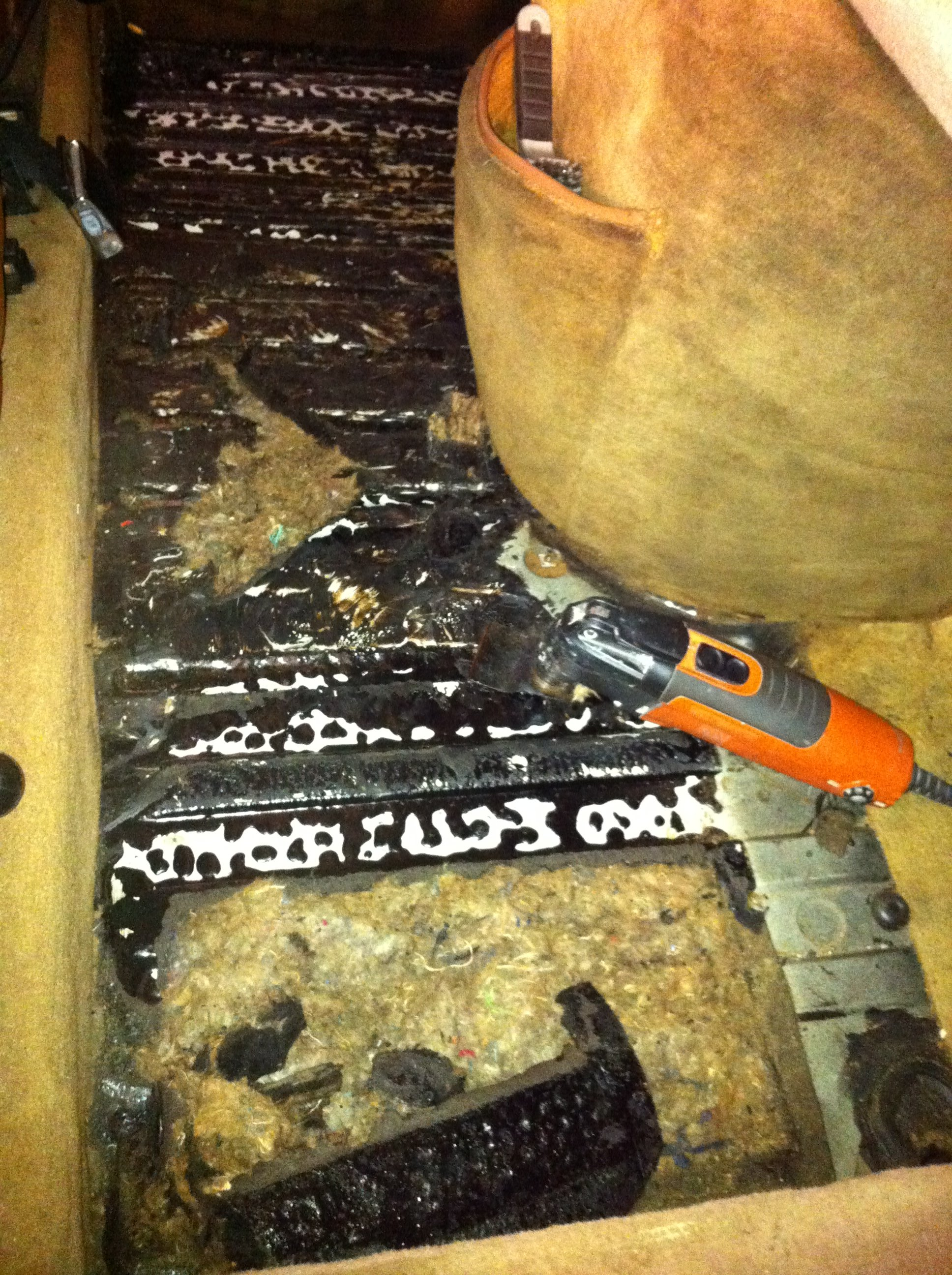 I closed the garage door, fired up the keroene heater and scraped the oil-soaked carpet and insulation off the front floorboards using my Fein tool.