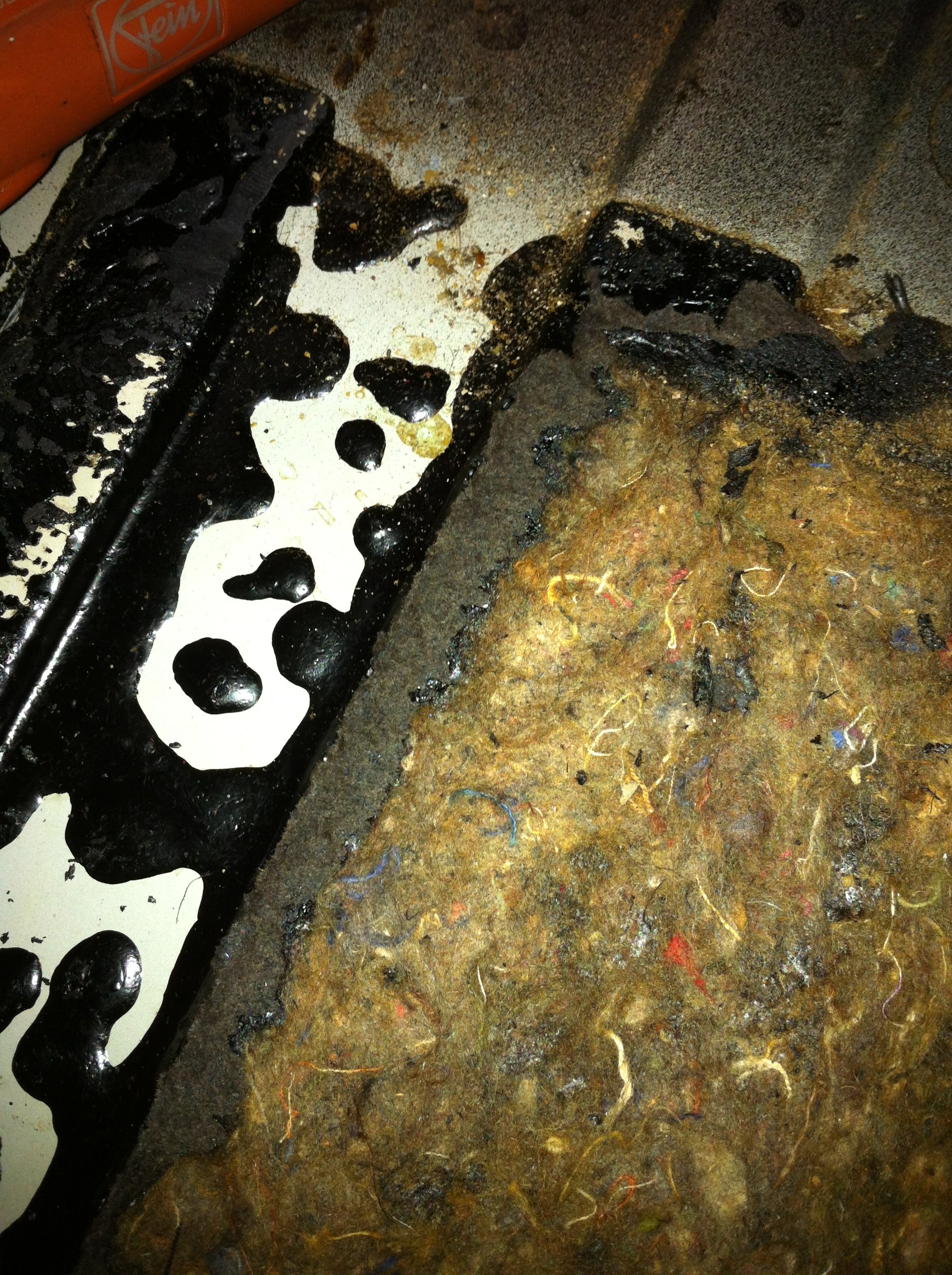 The metal is pristine under the insulation, it was installed with some very thick black tar which appears to have successfully prevented any rust at all :-)