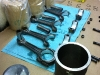 Assembling the pistons, pins and connecting rods
