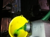 I pour new LHM fluid into the hydraulic reservoir