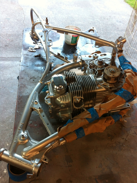 I lay the engine on the table and install the frame around it, easy job for one person!