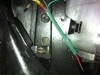 I use a heat-shrink terminal end for the ground wire and more green heat-shrink.