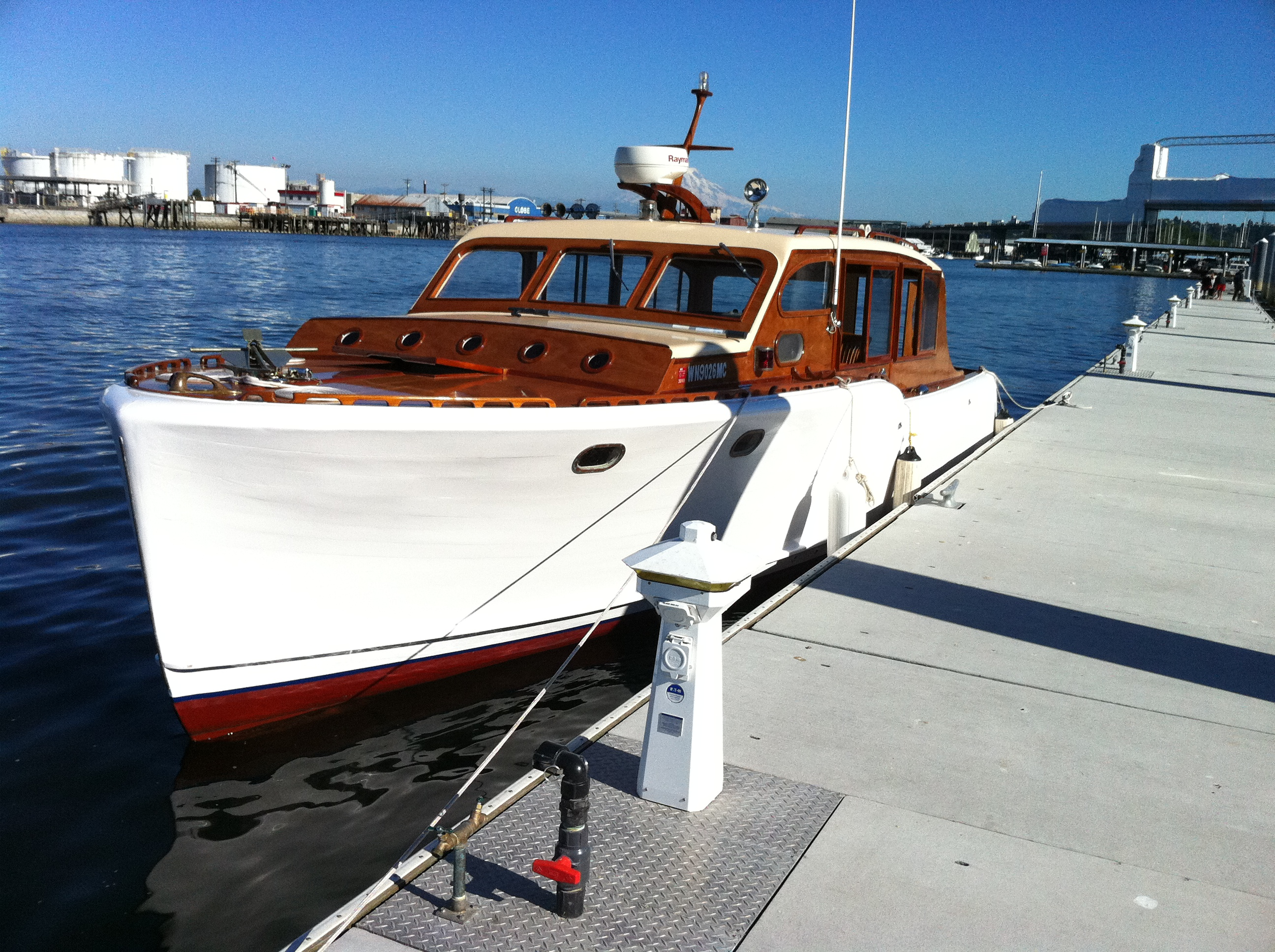 30\' LOA, 9 tons max. displacement, cruise 9 knots at 75% power. Less than one gallon per hour at 75%, top speed 12 knots. 8\' Avon tender.