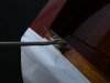 I do some touch-up on the aft gunwales where I had faired the new transom cap wood into the rounded gunwales.