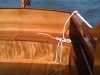 All new mahogany from the gunwales up. Hull is bronze-fastened (refastened 2011) Port Orford Cedar.