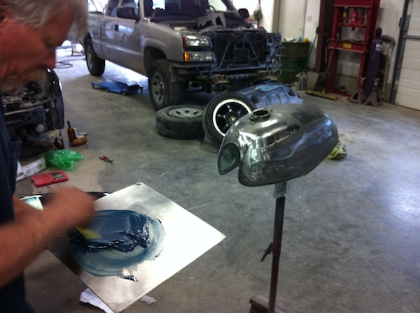 Pat uses Evercoat fiberglass filler to get the final shape on the tank