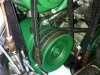 The main hydraulic pump is driven by two belts and it drives the clutch regulator (above the pump) with another belt.